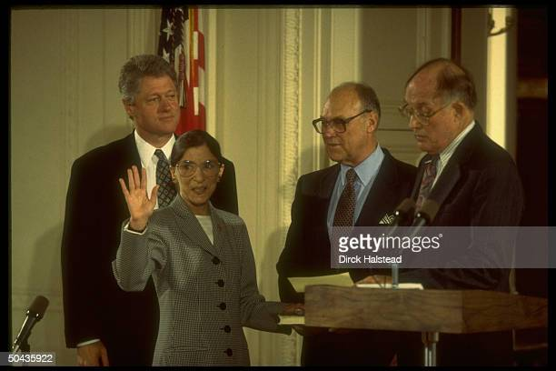 Supreme Court Chief Justice William Rehnquist swearing in new justice Ruth Bader Ginsburg as husband Martin & Pres. Bill Clinton look on.