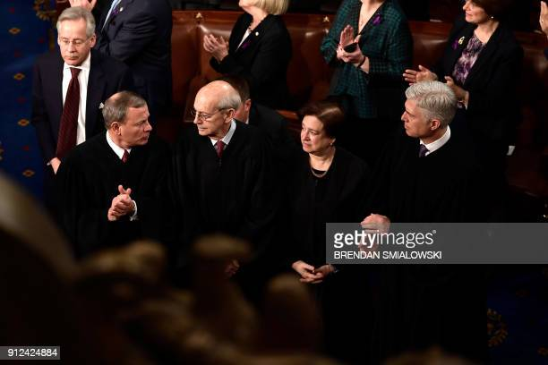 Supreme Court Judges John G Roberts Jr Stephen G Breyer Elena Kagan and Neil Gorsuch listen during the State of the Union address on Capitol Hill...