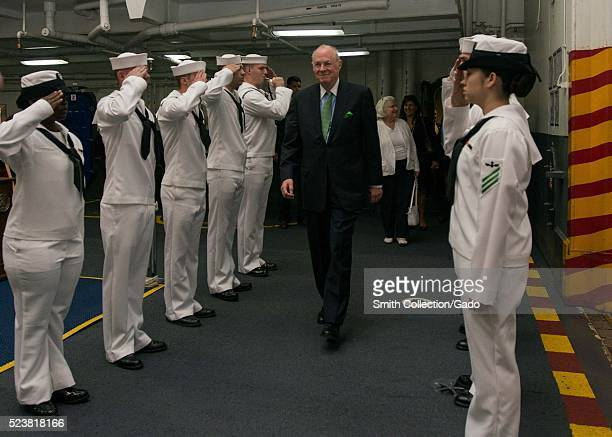 US Supreme Court Justice Anthony Kennedy is piped aboard the aircraft carrier USS John C Stennis CVN 74 for a tour of the ship San Diego California...