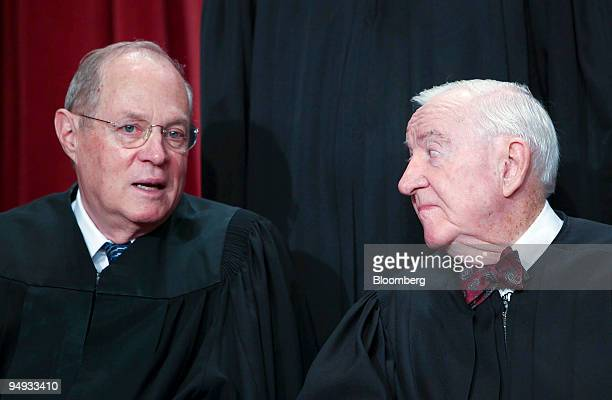 S Supreme Court Justice Anthony Kennedy left chats with Justice John Paul Stevens during the court's official photo session in Washington DC US on...