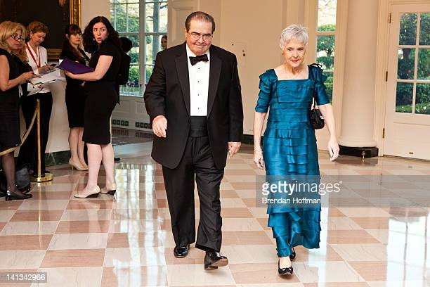 S Supreme Court Justice Antonin Scalia and Maureen M Scalia arrive for a State Dinner in honor of British Prime Minister David Cameron at the White...