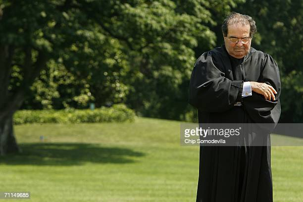 Supreme Court Justice Antonin Scalia listens to remarks after participating in the swearing in of new Interior Secretary Dirk Kempthorne on the South...