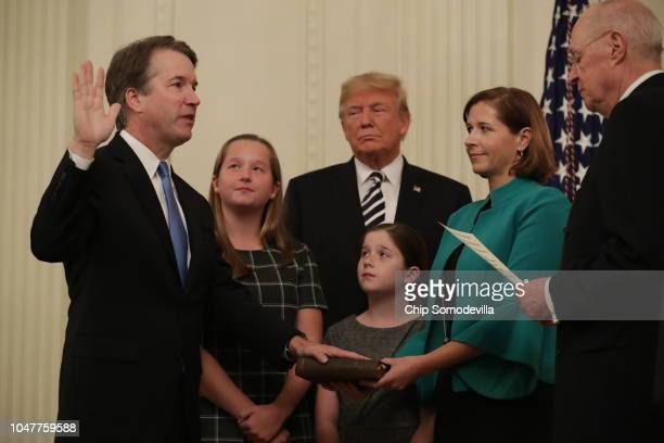 Supreme Court Justice Brett Kavanaugh participates in a ceremonial swearing in by retired Justice Anthony Kennedy as President Donald Trump,...