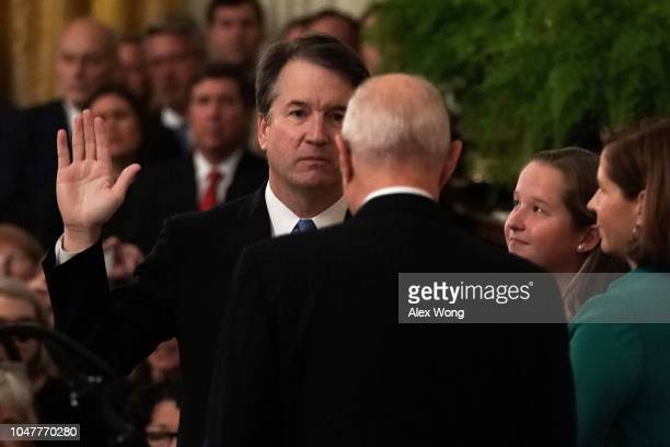 S Supreme Court Justice Brett Kavanaugh participates in a ceremonial swearing in by retired Justice Anthony Kennedy as Kavanaugh's wife Ashley and...