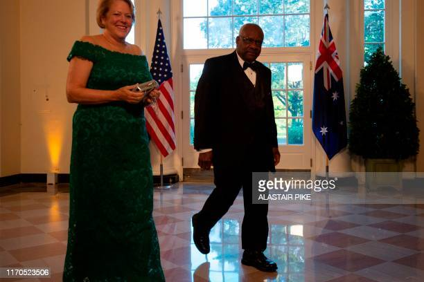 Supreme Court Justice Clarence Thomas and his wife Virginia arrive in the Booksellers area of the White House to attend a state dinner honoring...