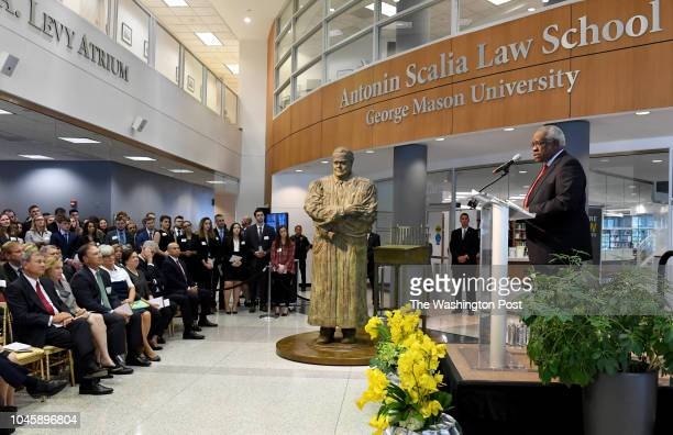 Supreme Court Justice Clarence Thomas speaks to the crowd gathered including Chief Justice John G Roberts his wife Jane Sullivan Roberts Justice...
