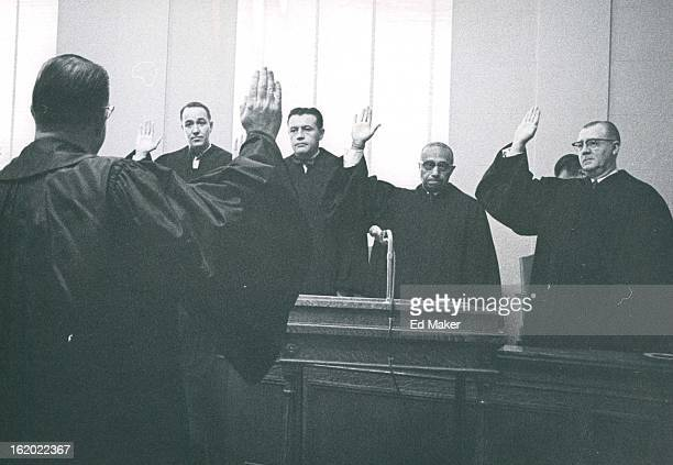 JAN 12 1965 Supreme Court Justice Edward Day administers the oath of office to from let Denver District Judges Merle Knous Ed Byrne James Flanigan...