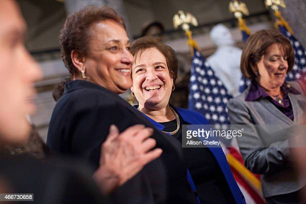 S Supreme Court Justice Elena Kagan C socializes with CEO of AARP Jo Ann Jenkins and other attendees at an annual Women's History Month reception...