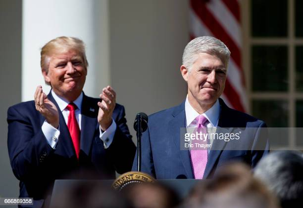 S Supreme Court Justice Judge Neil Gorsuch speaks as President Donald Trump looks on during a ceremony in the Rose Garden at the White House April 10...