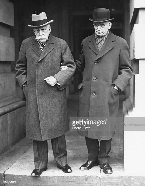 US Supreme Court Justice Louis D Brandeis is seen here leaving the Supreme Court with Supreme Court Justive Oliver Wendel Holmes on the 90th birthday...