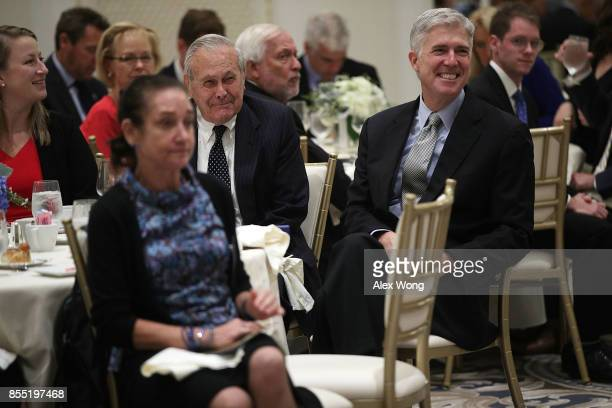 S Supreme Court Justice Neal Gorsuch and former Secretary of Defense Donald Rumsfeld listen during an event hosted by The Fund for American Studies...