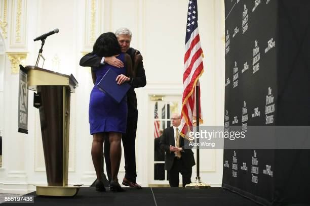 S Supreme Court Justice Neal Gorsuch hugs Mary Elizabeth Taylor a TFAS program alumnus of 2010 who introduces him during an event hosted by The Fund...