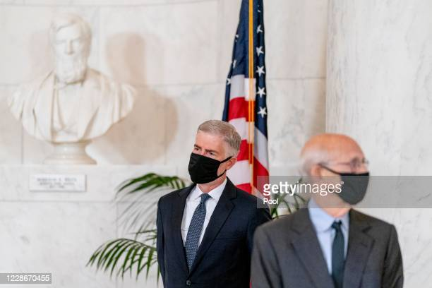 Supreme Court Justice Neil Gorsuch , and Justice Stephen Breyer, stand during a private ceremony for Associate Justice Ruth Bader Ginsburg at the...