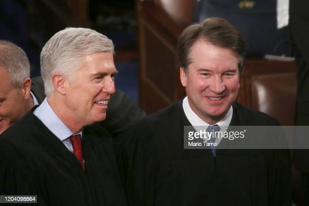 Supreme Court Justice Neil Gorsuch and Supreme Justice Brett Kavanaugh attend the State of the Union address in the chamber of the U.S. House of...
