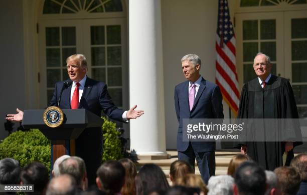 Supreme Court Justice Neil Gorsuch center along side Justice Anthony Kennedy right listen as President Donald Trump speaks before the searing in...