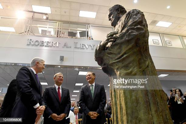 Supreme Court Justice Neil Gorsuch Chief Justice John G Roberts and Justice Samuel Alito admire the statue to Antonin Scalia at George Mason...