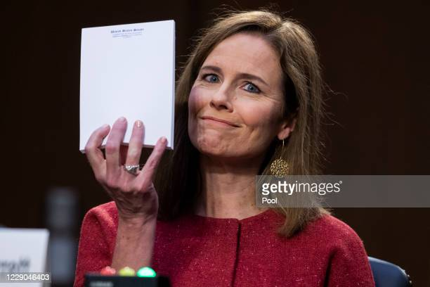 Supreme Court justice nominee Amy Coney Barrett holds up her notepad at the request of Sen. John Cornyn, R-Texas, on the second day of her Senate...