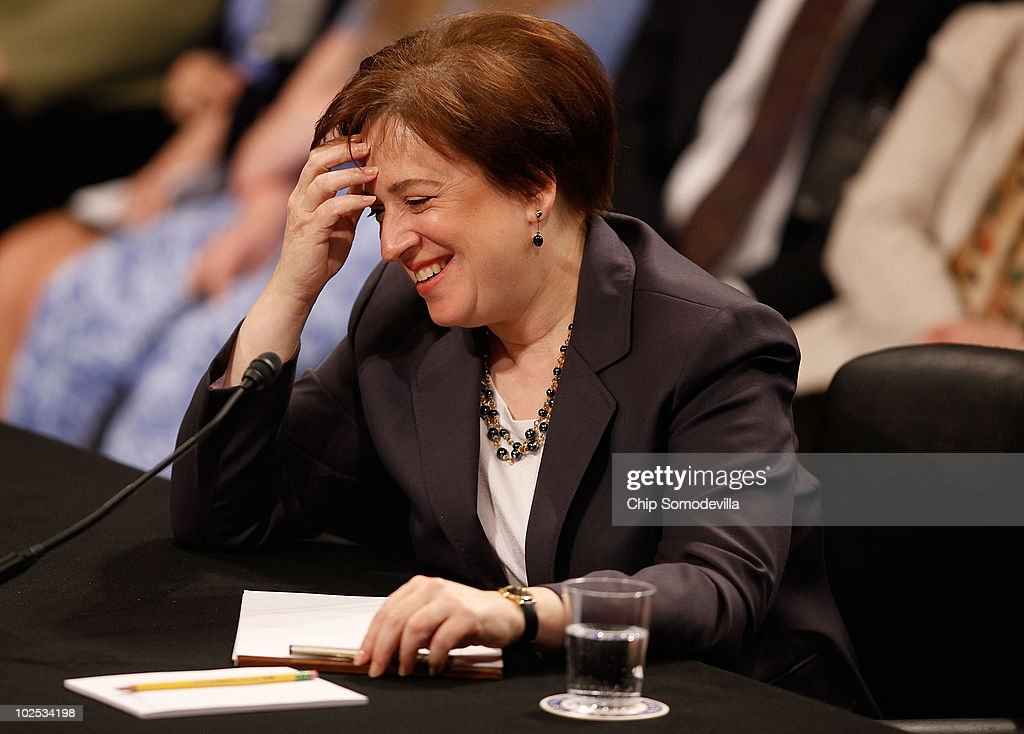 U.S. Supreme Court Justice nominee Elena Kagan reacts after referring to Senate Judiciary Committee member Sen. Tom Coburn (R-OK) as 'Justice Coburn' during the second day of her confirmation hearings on Capitol Hill June 29, 2010 in Washington, DC. Kagan is U.S. President Barack Obama's second Supreme Court nominee since taking office.