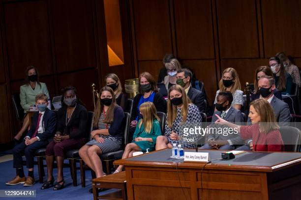Supreme Court Justice nominee Judge Amy Coney Barrett introduces her family on the second day of her Supreme Court confirmation hearing before the...