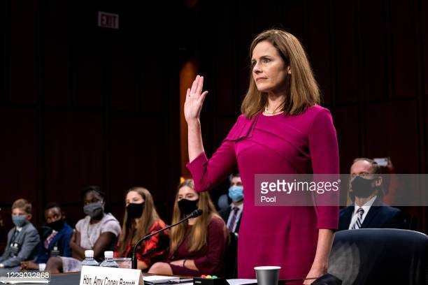 Supreme Court Justice nominee Judge Amy Coney Barrett is sworn in during the Senate Judiciary Committee confirmation hearing for Supreme Court...