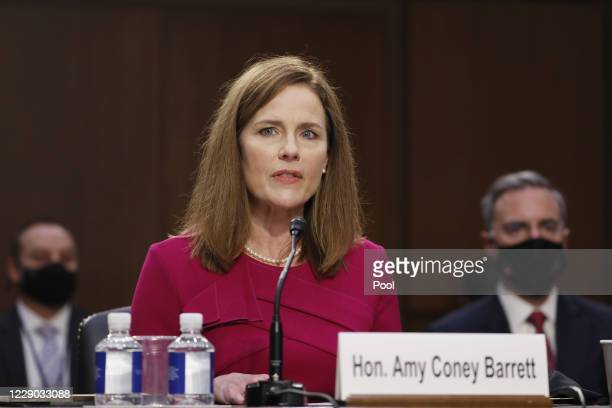 Supreme Court Justice nominee Judge Amy Coney Barrett speaks as she is sworn in during the Senate Judiciary Committee confirmation hearing for...
