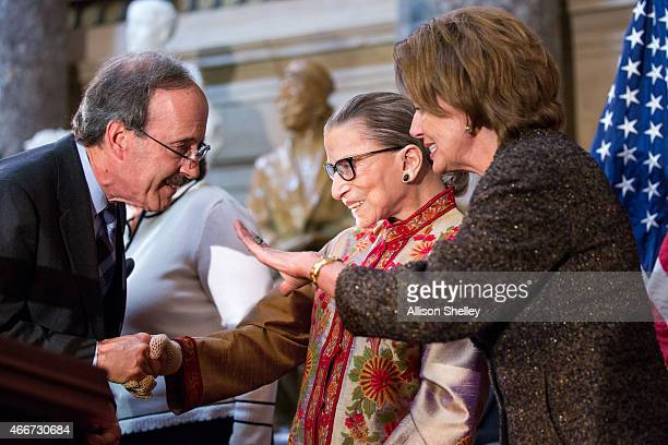 S Supreme Court Justice Ruth Bader Ginsburg C and Democratic House Leader Nancy Pelosi R greet other attendees at an annual Women's History Month...