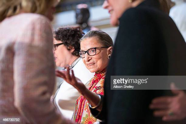 S Supreme Court Justice Ruth Bader Ginsburg C greets other attendees at an annual Women's History Month reception hosted by Pelosi in the US capitol...