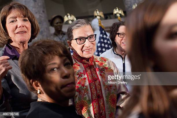 S Supreme Court Justice Ruth Bader Ginsburg C poses for a photo with other attendees at an annual Women's History Month reception hosted by...