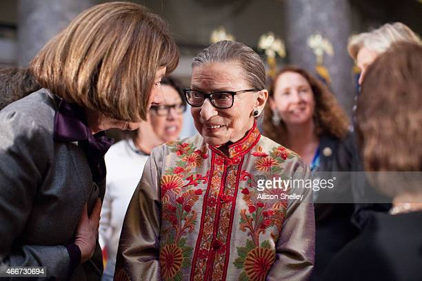 S Supreme Court Justice Ruth Bader Ginsburg C socializes with other attendees at an annual Women's History Month reception hosted by Democratic House...