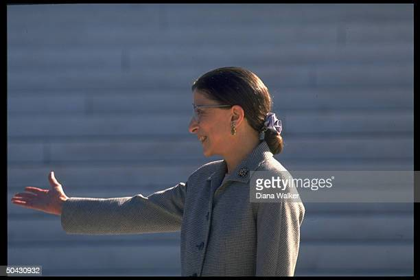 Supreme Court Justice Ruth Bader Ginsburg extending hand poised outside Supreme Court bldg after newest associate justice took her oath