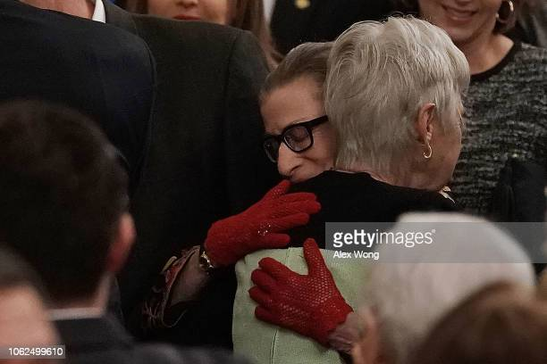 S Supreme Court Justice Ruth Bader Ginsburg hugs Maureen Scalia widow of the late Justice Antonin Scalia during a presentation ceremony of the...