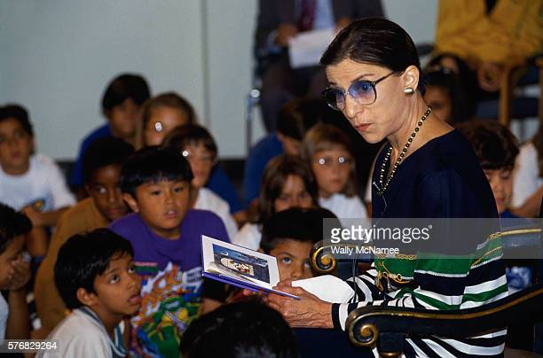 "Supreme Court Justice Ruth Bader Ginsburg reads to a group of children from a story book at the 10th Anniversary of TV's ""Reading Rainbow""."