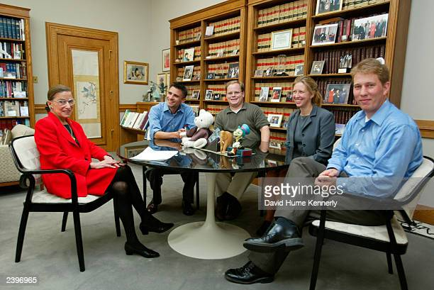 US Supreme Court Justice Ruth Bader Ginsburg sits in her chambers at the Supreme Court with her clerks August 7 2002 in Washington DC Ginsburg is the...