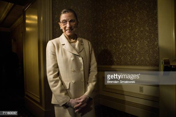 S Supreme Court Justice Ruth Bader Ginsburg waits to enter a dinner to honor Michelle Bachelet Chile's first female president May 8 2006 in...