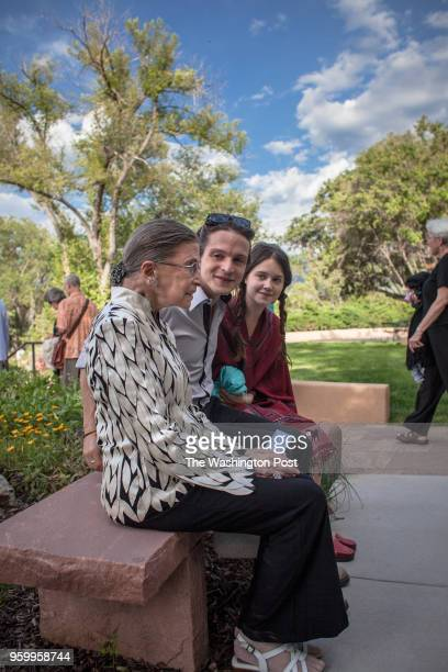 S Supreme Court Justice Ruth Bader Ginsburg waits with her grandson Paul Spera and his friend Audrey Bastien before being seated at the preview...