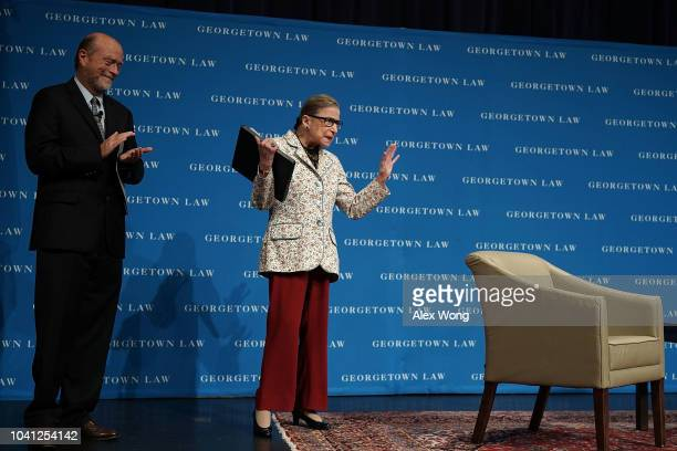 S Supreme Court Justice Ruth Bader Ginsburg waves to students as she arrives at a lecture September 26 2018 at Georgetown University Law Center in...