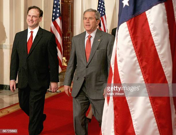 Supreme Court Justice Samuel Alito walks towards the podium with President George W. Bush before he is sworn in as Associate Justice of the United...