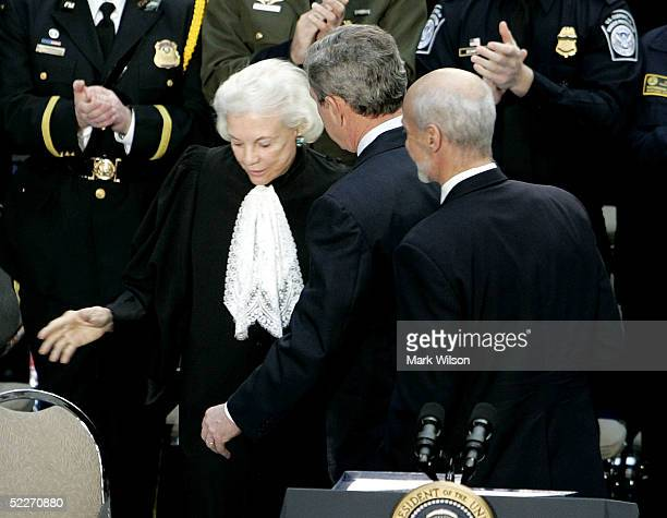 S Supreme Court Justice Sandra Day O'Connor recieves a hand from US President George W Bush after she swore in Michael Chertoff as Homeland Security...