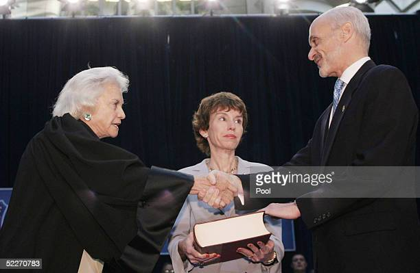 S Supreme Court Justice Sandra Day O'Connor shakes hands with Secretary of Homeland Security Michael Chertoff after he takes the oath of office as...