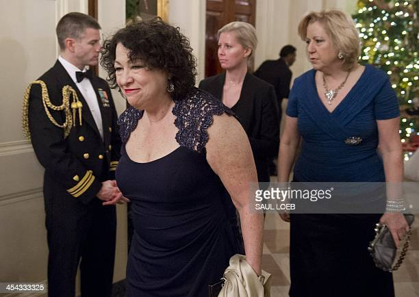 US Supreme Court Justice Sonia Sotomayor arrives for a reception for Kennedy Center honorees hosted by US President Barack Obama in the East Room of...