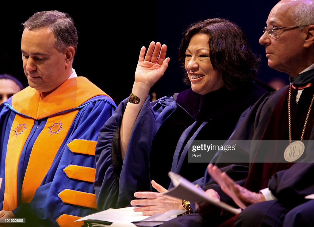 U.S. Supreme Court Justice Sonia Sotomayor gestures to the crowd before delivering the keynote address at the Hostos Community College 39th commencement ceremony June 4, 2010 in New York City. Also pictured are college President Felix Matos Rodriguez (L) and Dr. Matthew Goldstein, chancellor of City University of New York.