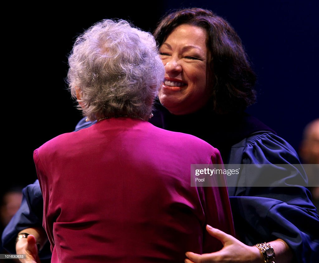 U.S. Supreme Court Justice Sonia Sotomayor hugs her mother Celina Sotomayor at the Hostos Community College 39th commencement ceremony June 4, 2010 in New York City. Also pictured are college President Felix Matos Rodriguez (L) and Dr. Matthew Goldstein, chancellor of City University of New York.