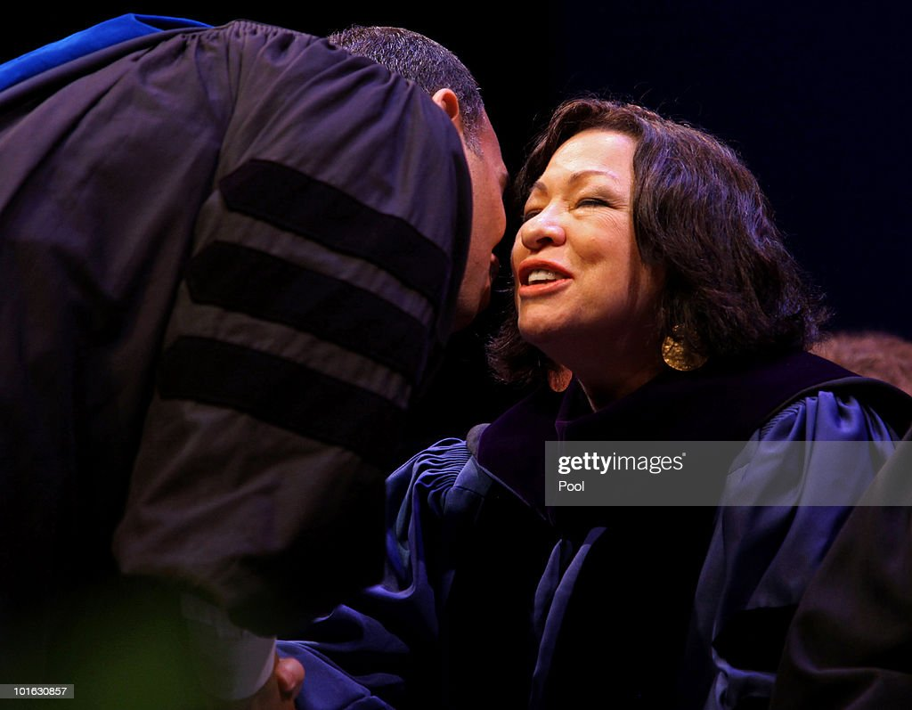 U.S. Supreme Court Justice Sonia Sotomayor is greeted by Bronx Borough President Ruben Diaz, Jr.at the Hostos Community College 39th commencement ceremony June 4, 2010 in New York City. Also pictured are college President Felix Matos Rodriguez (L) and Dr. Matthew Goldstein, chancellor of City University of New York.