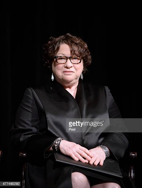 US Supreme Court Justice Sonia Sotomayor looks on before administering the oath of office for Attorney General Loretta Lynch at the Warner Theatre on...