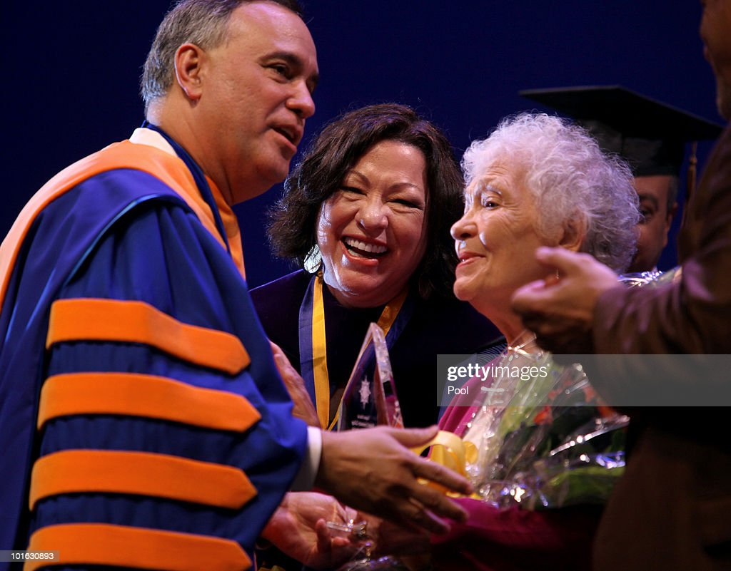 U.S. Supreme Court Justice Sonia Sotomayor stands with her mother Celina Sotomayor and college President Felix Matos Rodriguez at the Hostos Community College 39th commencement ceremony June 4, 2010 in New York City. Also pictured are college President Felix Matos Rodriguez (L) and Dr. Matthew Goldstein, chancellor of City University of New York.