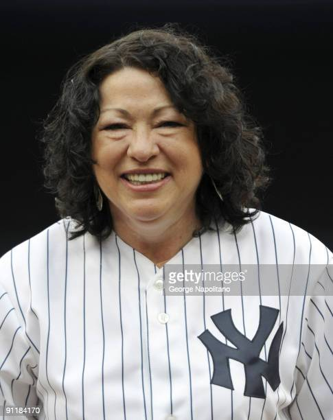 Supreme Court Justice Sonia Sotomayor throws out the first pitch at Yankee Stadium on September 26 2009 in New York City