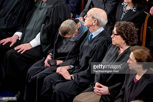 S Supreme Court Justice Stephen Breyer discretely nudges Justice Ruth Bader Ginsburg to keep her awake as President Barack Obama delivers the State...