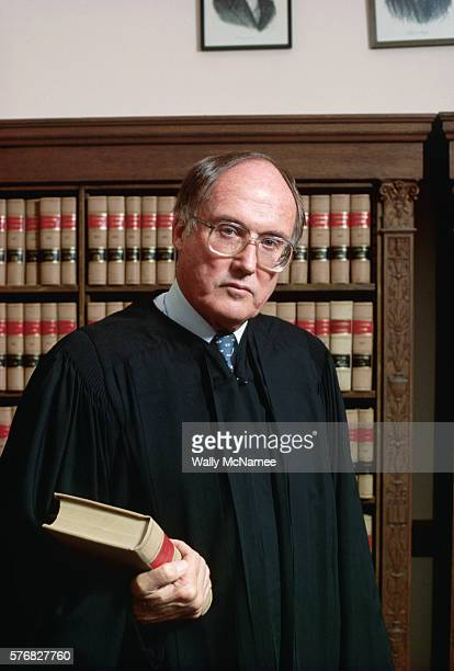 Supreme Court Justice William Rehnquist poses in his chamber on the day he became Chief Justice of the Supreme Court of the United States.