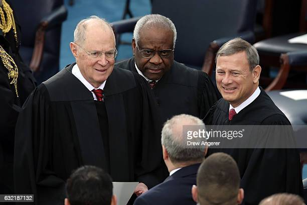 Supreme Court Justices Anthony Kennedy Clarence Thomas and John Roberts arrive on the West Front of the US Capitol on January 20 2017 in Washington...