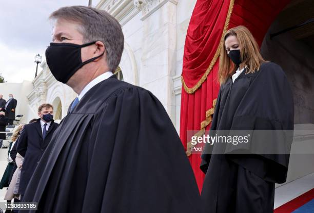 Supreme Court Justices Brett Kavanaugh and Amy Coney Barrett arrive for the inauguration of U.S. President-elect Joe Biden on the West Front of the...
